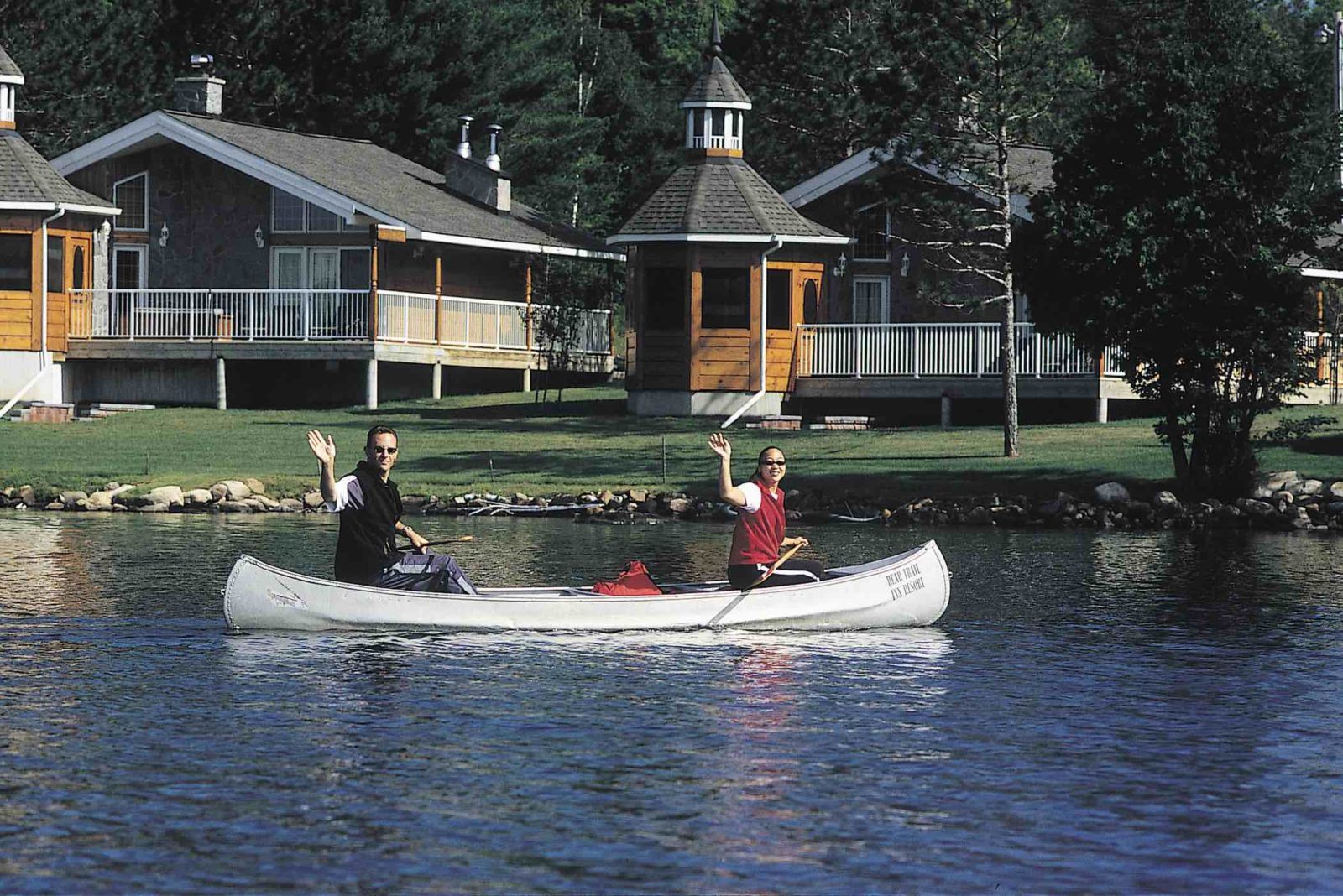 Couples Resort with couple in canoe