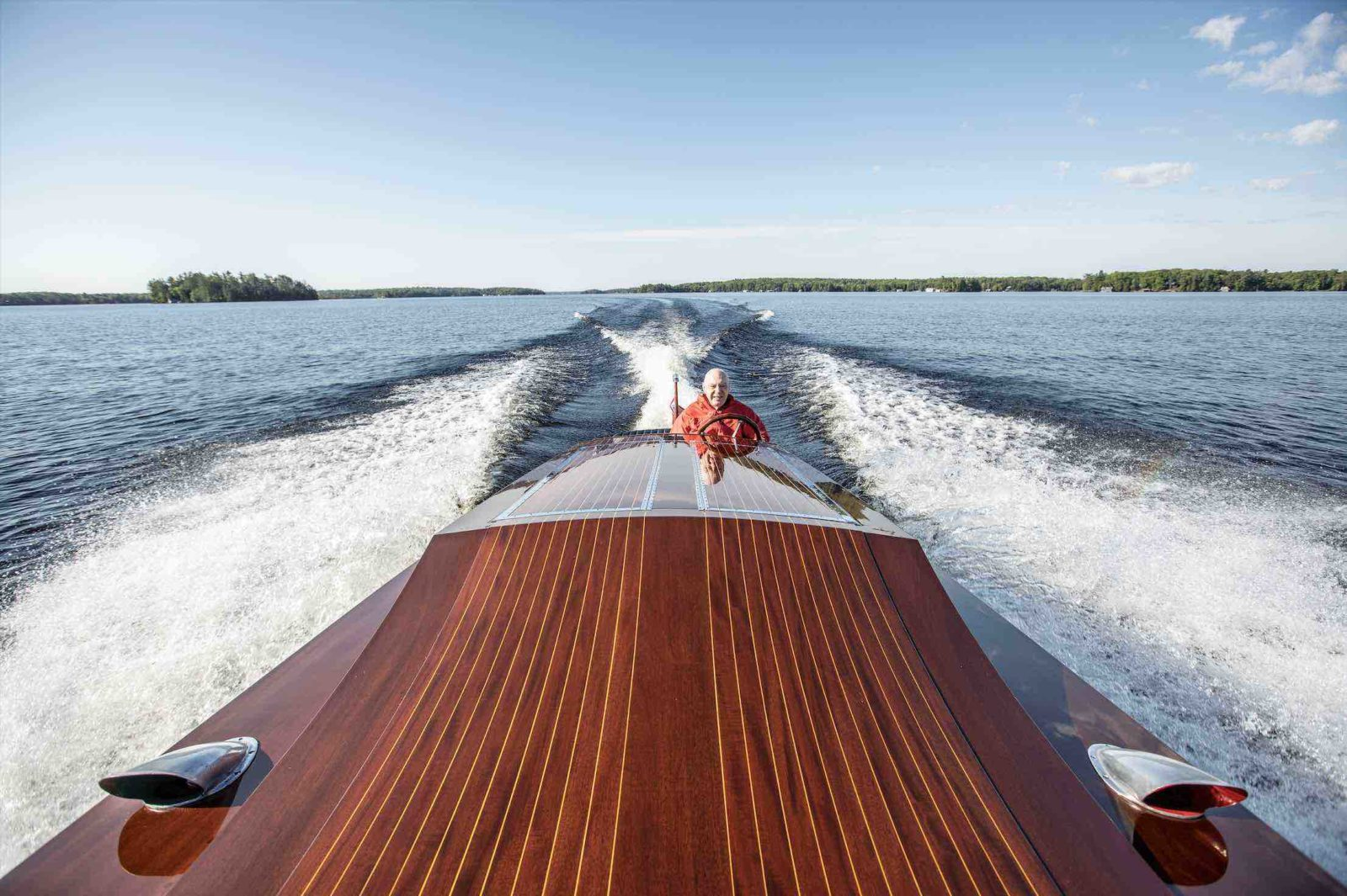 Murray Walker at the Wheel of Classic Boat Miss Supertest III racing across Muskoka Lakes