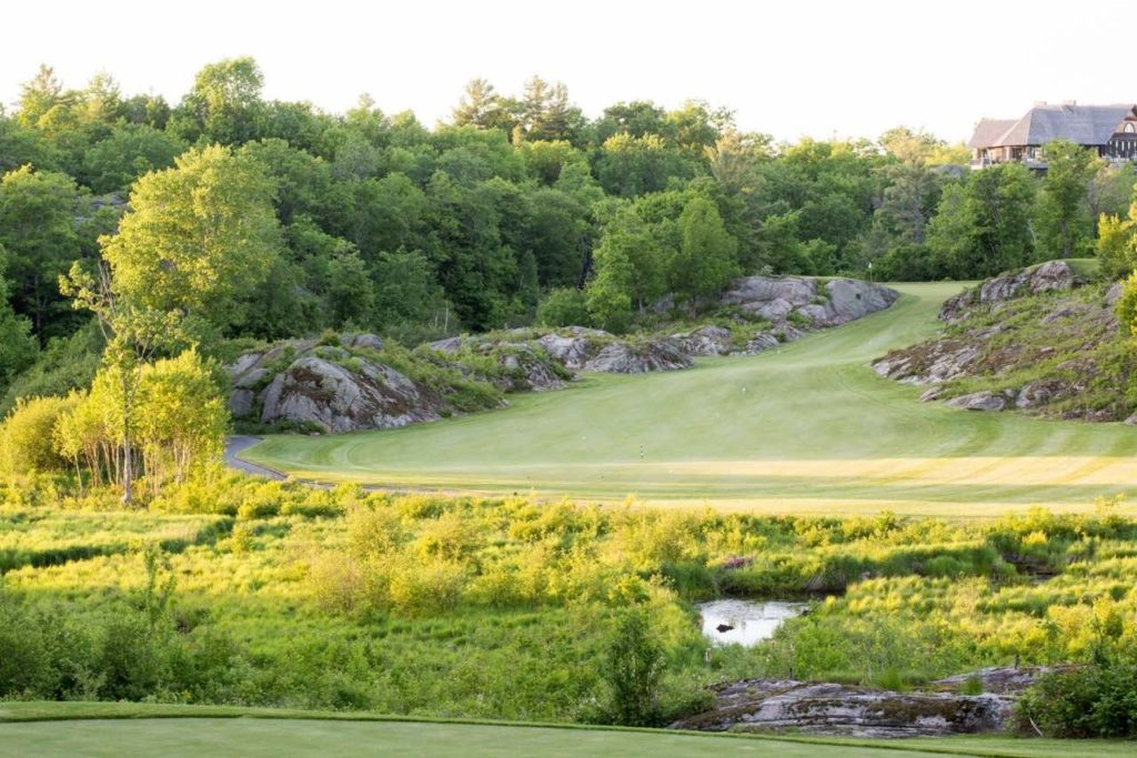 Muskoka Bay golf club's first hole is one of the top Muskoka golf courses holles